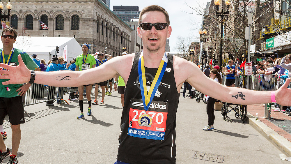 2014 Boston Marathon: finisher with medal in recovery zone, Ty Thurlow