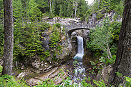 Christine Falls and the stone bridge over Van Trump Creek in Mount Rainier National Park, Washington State, USA
