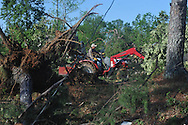 Men clear trees from the area near Pine Flat United Methodist Church in the Pine Flat area of Lafayette County south of Oxford, Miss. on Thursday, April 28, 2011. A Wednesday afternoon storm destroyed houses and uprooted trees.
