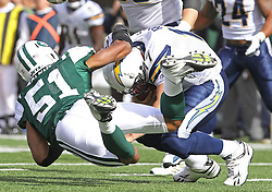 Oct 23, 2011; East Rutherford, NJ, USA; New York Jets linebacker Aaron Maybin (51) sacks San Diego Chargers quarterback Philip Rivers (17) during the first half at MetLife Stadium.