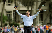Matt Kuchar celebrates a birdie out of the bunker on the 18th green to win the final round of the RBC Heritage golf tournament in Hilton Head Island, S.C., Sunday, April 20, 2014. Kuchar won the tournament with 11-under par. (AP Photo/Stephen B. Morton)