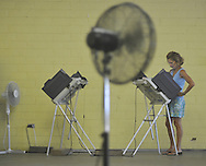 Jacqui Lear votes in a primary runoff election at the old National Guard Armory in Oxford, Miss. on Tuesday, August 23, 2011. (AP Photo/Oxford Eagle, Bruce Newman)