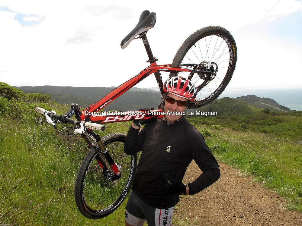 Hong Kong-based Pierre-Arnaud Le Magnan Chiru owner and founder with his Laktik X9 carbon mountain bike on the  Taramancho trail, Marin County, California, USA.