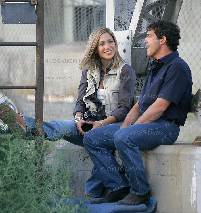 July 24, 2005 Albuquerque, New Mexico ***EXCLUSIVE*** Jennifer Lopez and Antonio Banderas in between takes on the set of Bordertown. Photo by Eric Ford 818-613-3955 info@onlocationnews.com