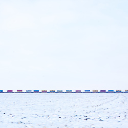 Yet another line of intermodal containers parades across the barren winter landscape in west-central Illinois on the BNSF mainline.
