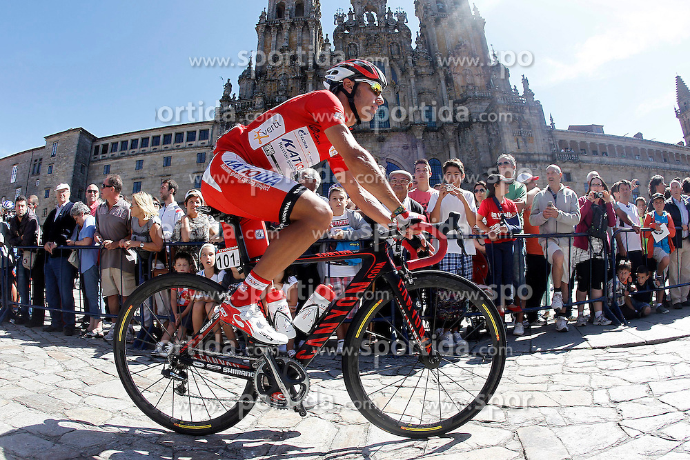 31.08.2012, 13. Etappe, Santiago de Compostella nach Ferrol, ESP, La Vuelta, im Bild Joaquin Purito Rodriguez passes by the front of the Obradoiro of the Cathedral of Santiago de Compostela // before the La Vuelta, Stage 13 Santiago de Compostella to Ferrol, Spain on 2012/08/31. EXPA Pictures © 2012, PhotoCredit: EXPA/ Alterphotos/ Acero..***** ATTENTION - OUT OF ESP and SUI *****