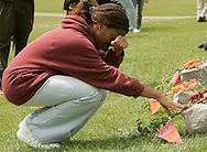 Whitley Johnson, a freshman at Virginia Tech touches one of the 32 stones symbolizing the victims shot in the Virginia Tech tragedy at a memorial on the campus in Blacksburg, Virginia April 18, 2007.  REUTERS/Rick Wilking (UNITED STATES)