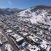 SHOT 3/2/17 11:29:32 AM - Aerial photos of Park City, Utah. Park City lies east of Salt Lake City in the western state of Utah. Framed by the craggy Wasatch Range, it's bordered by the Deer Valley Resort and the huge Park City Mountain Resort, both known for their ski slopes. Utah Olympic Park, to the north, hosted the 2002 Winter Olympics and is now predominantly a training facility. In town, Main Street is lined with buildings built primarily during a 19th-century silver mining boom that have become numerous restaurants, bars and shops. (Photo by Marc Piscotty / © 2017)