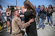 Lance Corp. Shane McMain shares a moment with his wife Madison, who is pregnant with their first child, during a homecoming reception at Camp Pendleton on Thursday, May 11, 2017 in Oceanside, California.   Marines and sailors from the 11th Marine Expeditionary Unit returned to Camp Pendleton after serving seven months in the Western Pacific, Middle East, and Horn of Africa.