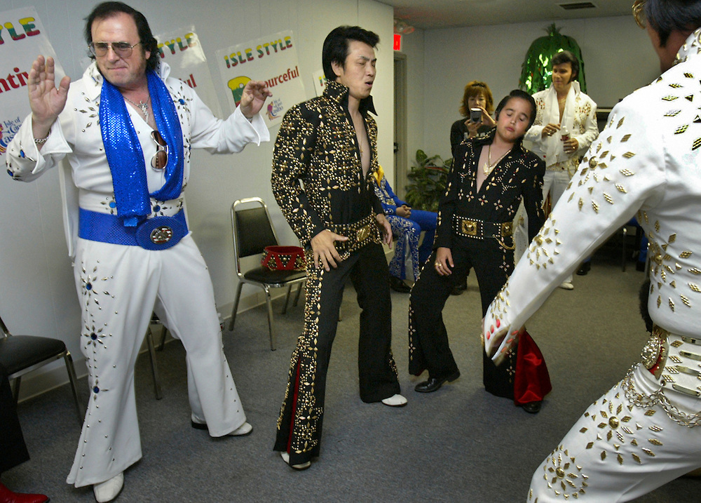 Elvis impersonators (l to r) Donnie Fox from Ohio, Mori Yasumasa from Japan, and Paul Ruprecht, 13, from San Diego and in background Wally Tiemer from Vancouver, sing and dance in the backstage area waiting for their turns to perform on stage  at the Elvis Impersonators Convention in Las Vegas on the 25th year anniversary of Elvis' death.