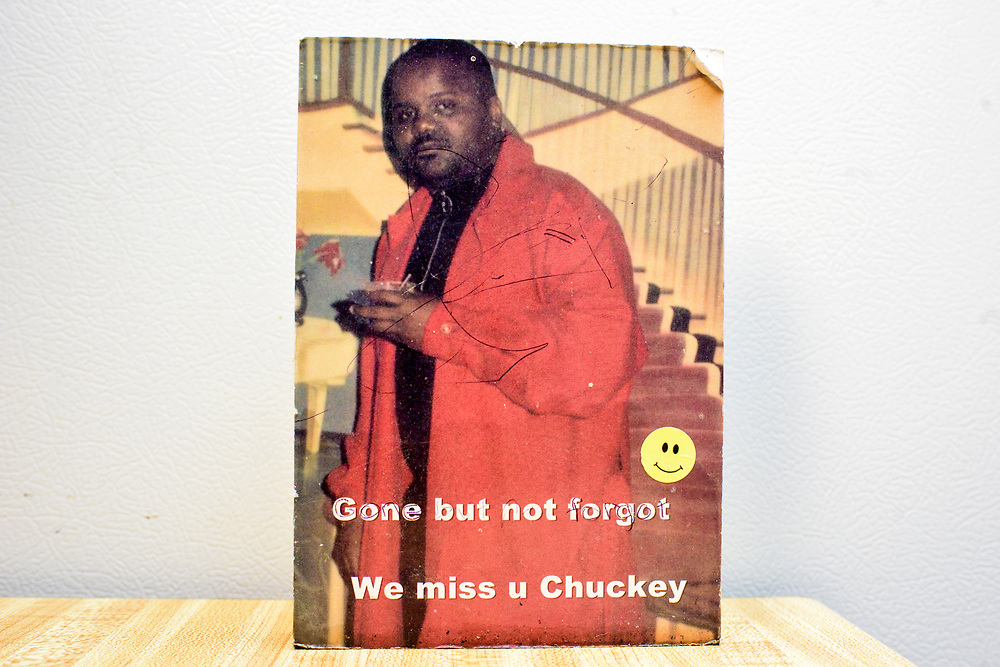 Washington, D.C. - April 03, 2017:  A memorial photo of Charles &quot;Chuckie&quot; Craig at his mother Claudette Craig's kitchen table in her Washington DC home Monday April 3, 2017. Claudette thinks Chuckie is in his 20's in the picture. <br /> <br /> She's lost two of her five children to gun violence. Charles &quot;Chuckie&quot; Craig, Kevin Durant's coach and mentor, was gunned down April 30th, 2005 in Laurel, Md., at the age of 35. Durant wears #35 as tribute to Craig.<br /> <br /> Her eldest, Ryan, a marine, was killed during a family visit to Georgia by a rival of his cousin when he was 20-years-old. <br /> <br /> NBA Superstar Kevin Durant's jersey number &quot;35&quot; is a tribute to his rec. league coach and mentor Charles &quot;Chuckie&quot; Craig, who was gunned down in at a night club in Laurel, Md., in 2005 when he was 35 years old. <br /> <br /> CREDIT: Matt Roth for The New York Times<br /> Assignment ID: 30204524A