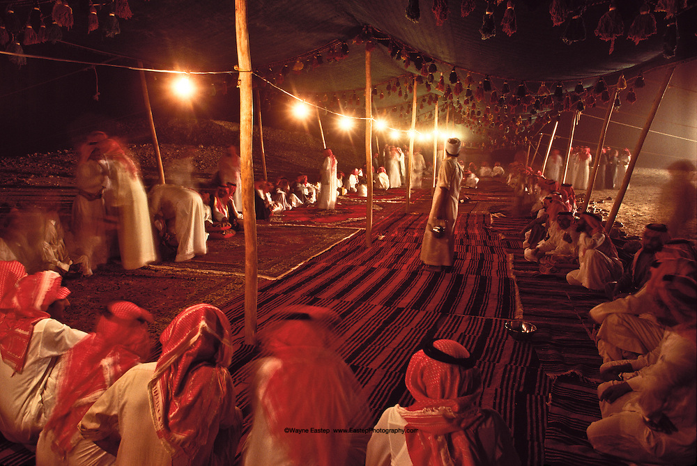 Gathering at the wedding of Mohammed Alerq.  Social protocol demands that everyone sit in a circle. Dahna Sands, Saudi Arabia