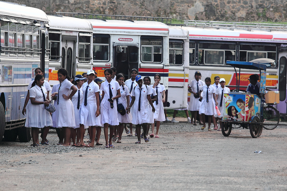 Schoolgirls head for a bus home, inside Galle Fort, in southern Sri Lanka
