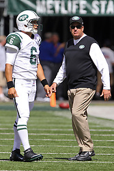 Sept 9, 2012; East Rutherford, NJ, USA; New York Jets head coach Rex Ryan and New York Jets quarterback Mark Sanchez (6) talk during the pre-game warmup for their game against the Buffalo Bills at MetLIfe Stadium.
