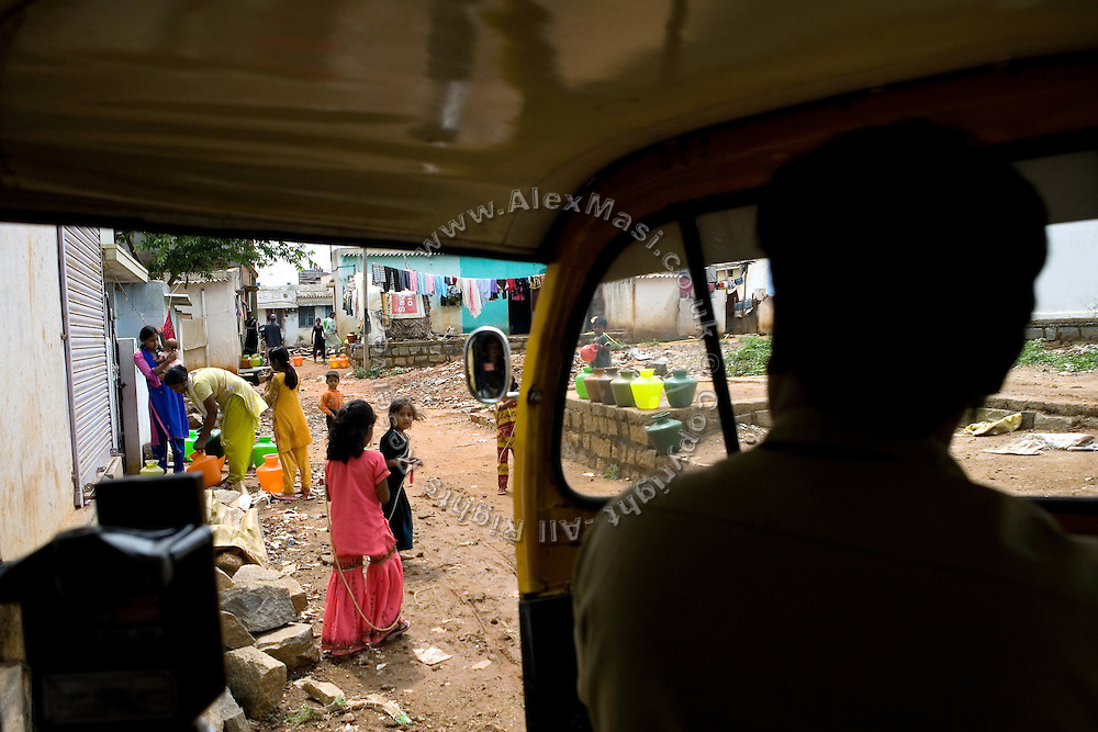 Shafiq Syed, 34, is driving his rickshaw in the streets surrounding the poor neighbourhood where he now lives with his family in Bangalore, Karnataka, India. Shaifq has been the main character of the Cannes' Camera D'Or 1988 winner Salaam Bombay, but after the movie he failed to become a star, fell back into poverty and lived on the streets for years before he became a rickshaw (tuk-tuk) driver in his home city of Bangalore, Karnataka State, India.