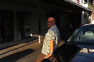 """Taxi driver Jose Alcocer waits for customers crossing into the city from Mexico on August 19, 2010 in Laredo, Texas. Alcocer claims to have made eight to ten trips per day into Mexico by American tourists before the start of the increase in border violence in recent years. Now he says he is lucky to make two or three. """"We don't even make enough for beans,"""" said Alcocer."""