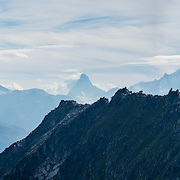 """See the Dom, Matterhorn and Weisshorn (left to right) from Eggishorn, in the Pennine Alps, Valais/Wallis canton, Switzerland, Europe. The Dom (4545 m / 14,911 ft) is the third highest mountain in the Alps and the second highest in Switzerland (after Monte Rosa). Located in the Pennine/Valais Alps between Randa (in Matter Valley) and Saas-Fee, the Dom is the main summit of the Mischabel Group (German: Mischabelhörner), the highest massif lying entirely in Switzerland. The Mischabel Group (ancient German term for pitchfork) includes many summits above 4000 meters: the Nadelgrat, composed of the Lenzspitze, the Nadelhorn (4327 m/14,196ft """"Needle Peak""""), Stecknadelhorn, Hohberghorn and Dürrenhorn; and Täschhorn (4491 m south/just left of highest peak in photo), plus the flat summit of the Alphubel (4206m / 13,799ft, further left). This image was stitched from multiple overlapping photos."""