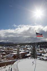 """American Flag over Truckee"" - This American flag was photographed from the Rocking Stone in Downtown Truckee, CA."