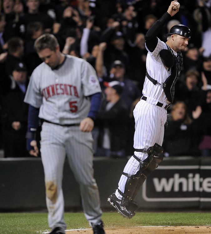 CHICAGO - SEPTEMBER 30:  A.J. Pierzynski #12 of the Chicago White Sox reacts after hanging onto the ball after Michael Cuddyer #5 slammed into Pierzynski while attempting to score in the 5th inning of the game against the Minnesota Twins at U.S. Cellular Field in Chicago, Illinois on September 30, 2008.  The White Sox defeated the Twins 1-0 to win the American League Central title.  The Sox and Twins had to play a one game playoff to determine the American League Central Champion.  (Photo by Ron Vesely)
