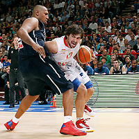 15 July 2012: Sergio Llull of Team Spain drives past Boris Diaw of Team France during a pre-Olympic exhibition game won 75-70 by Spain over France, at the Palais Omnisports de Paris Bercy, in Paris, France.