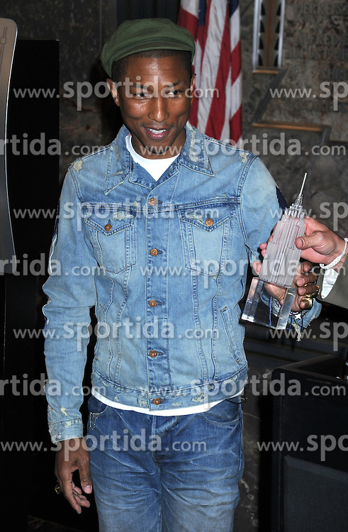 Pharrell Williams at a public appearance for Pharrell Williams Illuminates The Empire State Building for United Nations&rsquo; International Day of Happiness, Empire State Building, New York, NY March 20, 2015. EXPA Pictures &copy; 2015, PhotoCredit: EXPA/ Photoshot/ Dennis Van Tine<br /> <br /> *****ATTENTION - for AUT, SLO, CRO, SRB, BIH, MAZ only*****