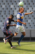 CAPE TOWN, South Africa - Monday 21 January 2013, Bongane Theletsane of Jomo Cosmos challenges Michael Lang of Grasshopper Club Zurich during the soccer/football match Grasshopper Club Zurich (Switzerland) and Jomo Cosmos at the Cape Town stadium..Photo by Roger Sedres/ImageSA