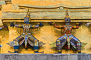 Demons defend a gilded chedi (or stupa), at the Temple of the Emerald Buddha (Wat Phra Kaew), a shining complex of buildings within the grounds of the Grand Palace in Bangkok, Thailand. The Grand Palace (Phra Borom Maha Ratcha Wang) was built on the east bank of the Chao Phraya River starting in 1782, during the reign of Rama I. It served as the official residence of the king of Thailand from the 1700s to mid 1900s.