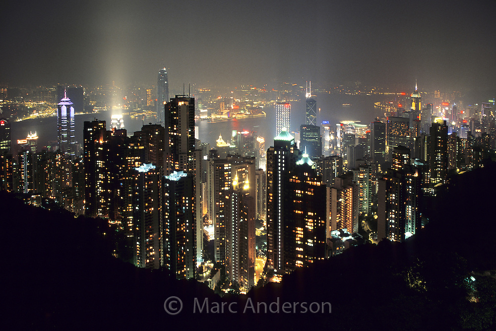 Skyscrapers & the Central skyline at night as viewed from Victoria Peak, Hong Kong, China.