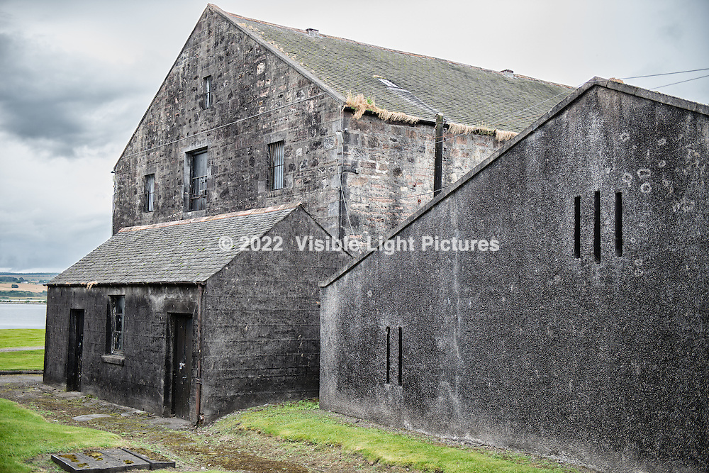 Storage buildings on the Dalmore property.  Casks of whiskey are stored inside.  The dark coloring on the walls is a fungus that lives (quite happily I would imagine) off of the alcohol vapors that seeps out of the barrels.