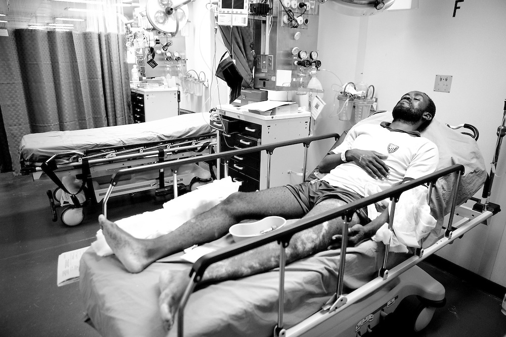A Haitian man lies in the casualty receiving area on board the USNS Comfort, a U.S. Naval hospital ship, on January 21, 2010 in Port-au-Prince, Haiti. The Comfort deployed from Baltimore with 550 medical personnel on board to treat victims of Haiti's recent earthquake, and arrived on January 20.