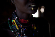 A woman wears beads signifing the generational group of her husbend.