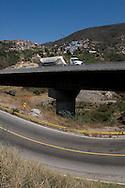 Truck passing across the venezuelan major bridge called viaduct #1. This bridge is the key route to the country's main airport in Venezuela. Feb 27 2008. (ivan gonzalez).
