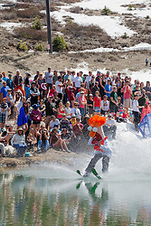 """Cushing Classic at Squaw Valley 17"" - Photograph of a skier crossing a pond during the Cushing Classic at Squaw Valley, USA."