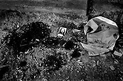 All that remains of a local village leader is a trail of blood and an image of Christ laid upon the remains by locals as a mark of respect. The man was murdered by Pro-autonmony Militia. August 1999