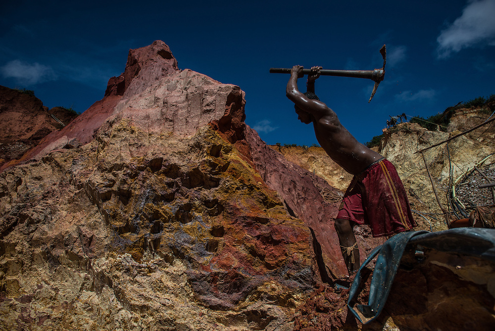 """LAS CLARITAS, VENEZUELA - JULY 20, 2016:  Carlos Freydel, 26, mines for gold at """"Cuatro Muertos"""" mine outside of Las Claritas.  Freydel said he has fallen ill with malaria 60 times during the 9 years he has worked illegally mining for gold. When he gets malaria, it usually keeps him from being able to work in the mine for a full week.  Even though he has suffered so much from malaria, """"it is worth it, because there is money here,"""" he said.  He mistakingly thinks that he gets malaria from the water, and did not believe visiting journalists that said he gets it from being bit by mosquitos.  Thousands of Venezuelans are flocking to illegal gold mines, like this one, in hopes of surviving the current economic crisis by earning in gold instead of the national currency, whose value steadily falls due to the world's highest inflation.  From this remote part of the jungle the migrant miners have become the vectors of a new epidemic of malaria, because the hot, swampy conditions of the mines make for an ideal breeding ground for mosquitos. Miners spread the disease as they return home with earnings or pay visits to family members. The economic crisis has also left the government without the financial resources to control the disease - they are unable to fumigate homes, provide medicines to everyone that is sick, or even to test all patients with symptoms of malaria in many places. PHOTO: Meridith Kohut"""