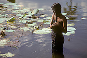 SRI LANKA, PEOPLE Women bathing in the lagoon at Anuradhapura