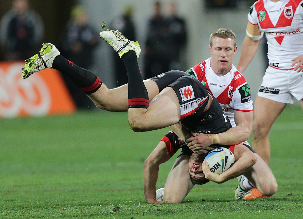 Jonathan Wright of the New Zealand Warriors is tackled by Captain Ben Creagh of the Dragons during their round 22 NRL match at Westpac  Stadium, Wellington on  Saturday, August 08, 2015. Credit: SNPA / David Rowland