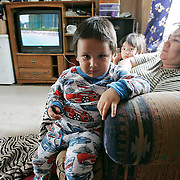 A young boy at his family's home, a four-bedroom bungalow which houses 17 people. Overcrowding is common. <br /> <br /> (Ian Stewart photo)