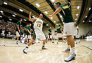 11 February 2009: Catamount senior guard Mike Trimboli #13 and Catamount sophomore forward Garrett Kissel #45 pump up the crowd during the starting line up introductions before the start of the Vermont Catamounts 75-47 win over the Boston Terriers at Patrick Gym in Burlington, Vermont.