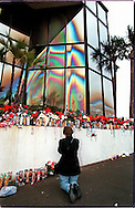 CLEARWATER, FLORIDA:  A woman prays beneath a likeness of the Virgin Mary after it appeared on the windows of the Ugly Duckling car rental business on U.S. 19 in Clearwater in December 1996. Since that time millions of people have visited the site. In 2004, a teenager used steel balls to destroy the windows. (Photo by Robert Falcetti). .