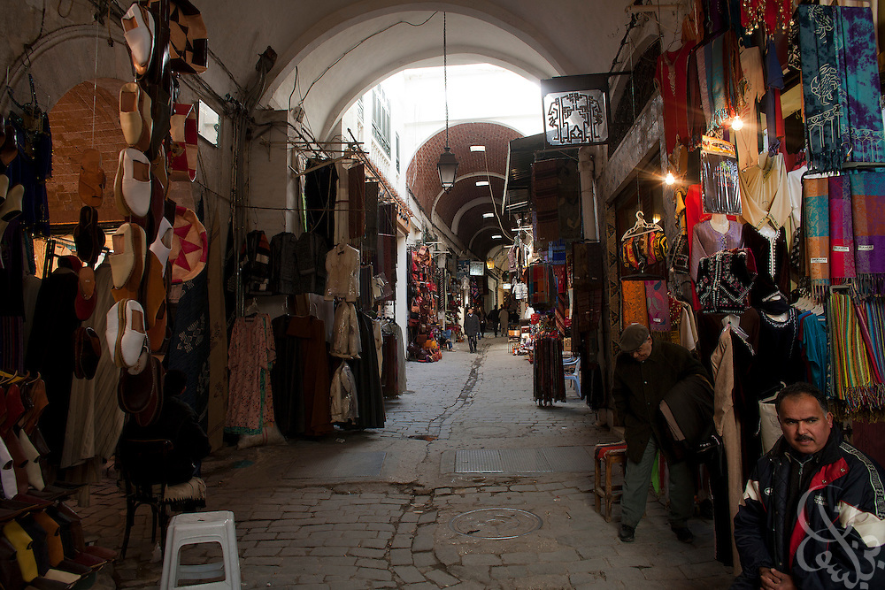 Tunisian shopkeepers sit amid nearly empty corridors in the old medina area March 05, 2012 in Tunis, Tunisia. The area is normally crowded with foreign tourists, however in the year since the revolution tourism numbers are dramatically down.