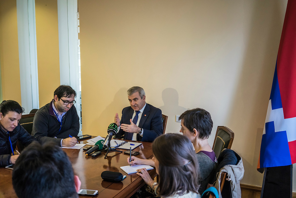 Ashot Ghoulyan, the Chairman of the National Assembly of the Republic of Nagorno Karabakh, is interviewed by foreign journalists in his office on Sunday, May 8, 2016 in Stepanakert, Nagorno-Karabakh.