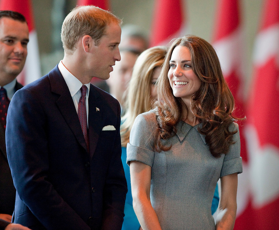 Catherine the Duchess of Cambridge smiles at her husband Prince William during a tour of the War Museum in Ottawa, Canada, July 2, 2011.<br /> AFP PHOTO/GEOFF ROBINS