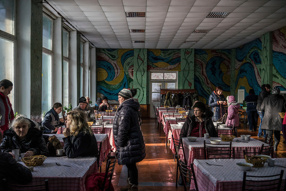 People who fled fighting between pro-Russia rebels and Ukrainian forces eat lunch in the canteen at the Perlyna Donetchyny children's resort, where they are temporarily seeking refuge, on Monday, February 9, 2015 in Svyatogorsk, Ukraine.