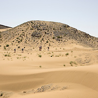 25 March 2007: Participants run between Irhs and Khermou during the first stage of  the 22nd Marathon des Sables, a 6 days and 151 miles endurance race with food self sufficiency across the Sahara Desert in Morocco. Each participant must carry his, or her, own backpack containing food, sleeping gear and other material.
