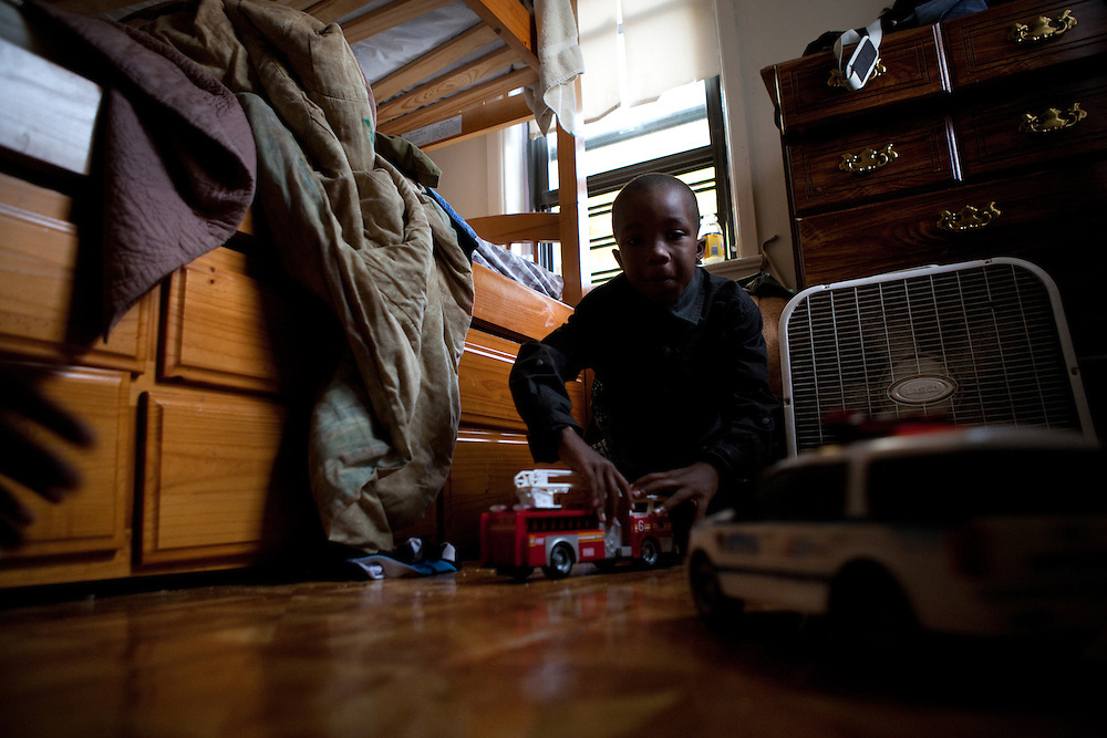 Ja'kye Brown, 7, plays in his room in the family apartment in Port Chester, NY on October 27, 2012. Cherie Michaux, his mother, could have benefitted if Westchester County had integrated its housing as it had been ordered to do so.