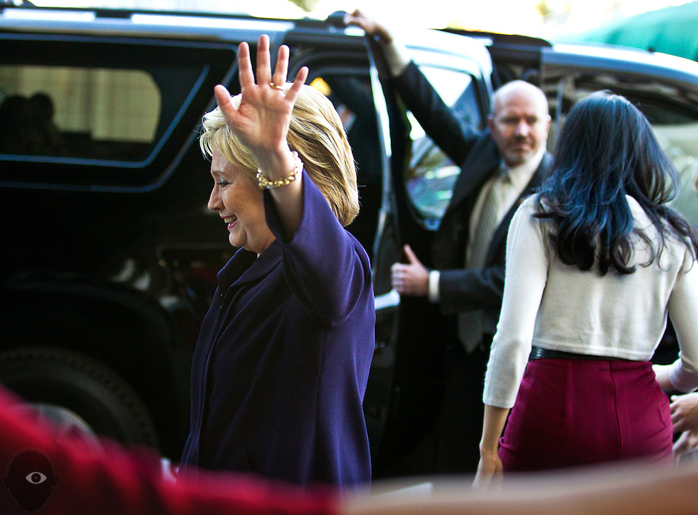 Secretary of State Hillary Clinton waves goodbye to hotel and casino workers outside the Paris on Wednesday, February 18, 2016.