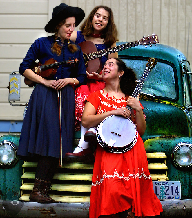 The Flat Mountain Girls play old-time music, they are Rachel Gold on banjo, Caroline Oakley on guitar and Lisa Marsicek on fiddle.