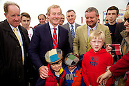 Taoiseach Enda Kenny with two boys wearing tweed hats at The National Ploughing Championships 2014.