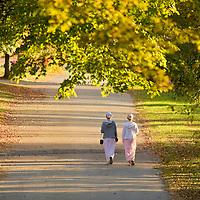 Mennonite girls walking path in Harrison, Arkansas